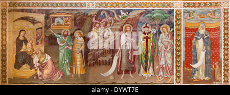 TREVISO, ITALY - MARCH 18, 2014: Fresco of Adoration of Magi and st. Margaret (1370) in saint Nicholas or San Nicolo - Stock Photo