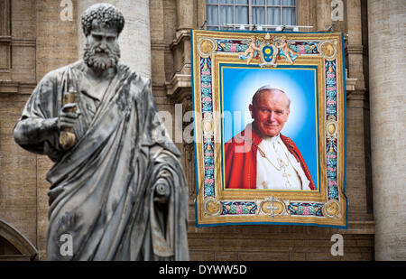Vatican, Rome, Italy. 26th Apr, 2014. A huge Poster with late Polish Pope John Paul II. is seen next to the Pius - Stock Photo