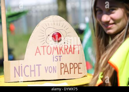 Brokdorf, Germany. 26th Apr, 2014. A protesters with a cardboard miniature nuclear power plant which reads 'nuclear - Stock Photo
