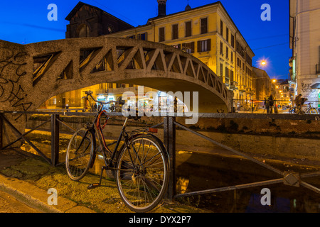 Bridge over Naviglio Grande canal, Milan, Lombardy, Italy - Stock Photo
