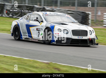 Bentley Continental GT3 Saloon Racing Car in British GT Championship at Oulton Park Motor Racing Circuit Cheshire - Stock Photo