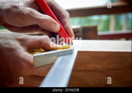 Carpenter using combination sqaure, Australia - Stock Photo