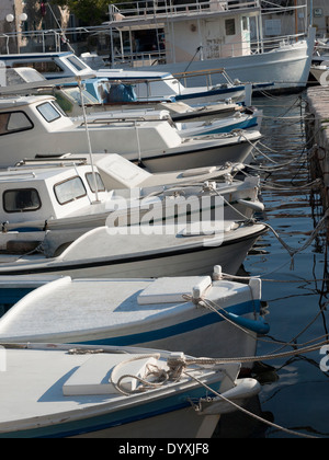 anchored fishing boats in the port - Stock Photo