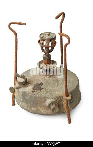Old rusty antique kerosene stove isolated on white background - Stock Photo