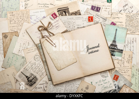 open empty diary book, old letters, french postcards - Stock Photo