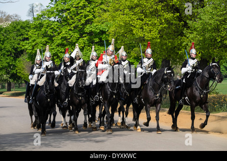 Mounted Household Cavalry soldiers on horseback in Hyde Park London United Kingdom - Stock Photo