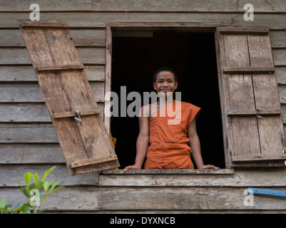 Young Buddhist monk in traditional robes at Angkor Wat, Siem Reap, Cambodia - Stock Photo