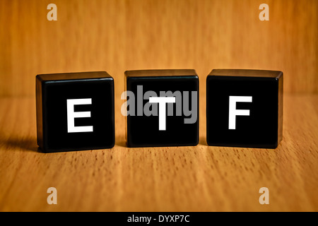 ETF or Exchange Traded Fund text on black block - Stock Photo