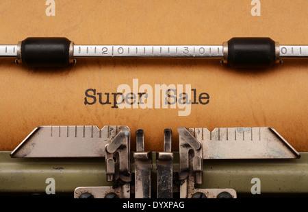 Super Sale text on typewriter - Stock Photo