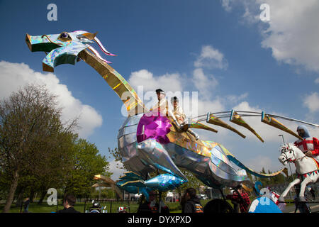 Manchester, UK 27th April, 2014. A large, gigantic, oversized metal, silver mechanical dragon at St George's weekend - Stock Photo