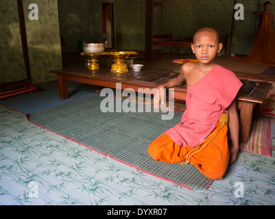 Young Buddhist monk in the communal living quarters at Angkor Wat, Siem Reap, Cambodia - Stock Photo