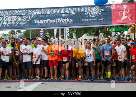 Runners at start of 2014 Mercedes-Benz Corporate Run in Miami, Florida, USA. - Stock Photo