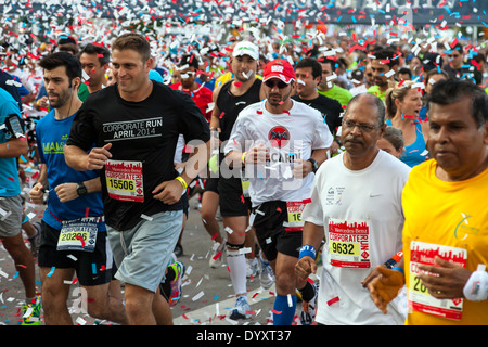 Throng of runners at start of 2014 Mercedes-Benz Corporate Run in Miami, Florida, USA. - Stock Photo