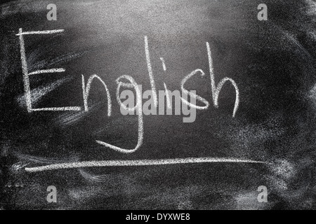 Learning language - English. Blackboard education concept. Handwritten message on a school chalkboard writing English - Stock Photo