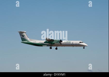 Wideroe's Flyeselskap DHC-8-402 LN-WDI Dash 8 approaching Aberdeen Dyce airport.  SCO 9066. - Stock Photo