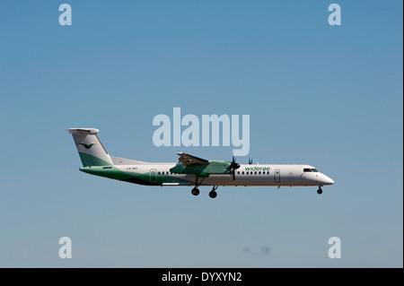 Wideroe's Flyeselskap DHC-8-402 LN-WDI Dash 8 arriving at Aberdeen Dyce airport.  SCO 9067. - Stock Photo