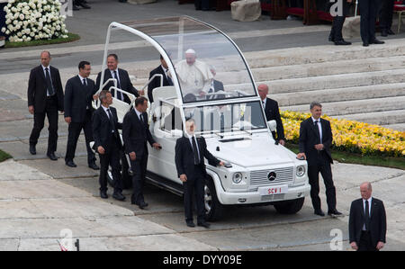 St Peter's Square, Vatican City. 27th Apr, 2014. Pope Francis waves to believers as he leaves the Canonization Service - Stock Photo