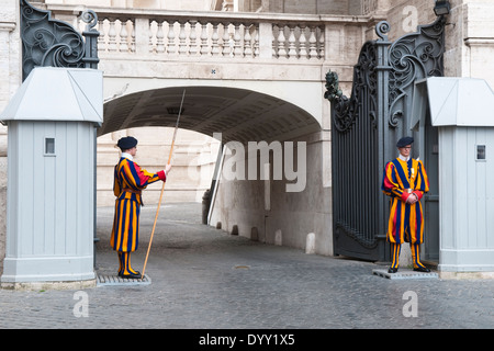 Two members of the Pontifical Swiss Guard at St Peter's Basilica in Vatican City - Stock Photo
