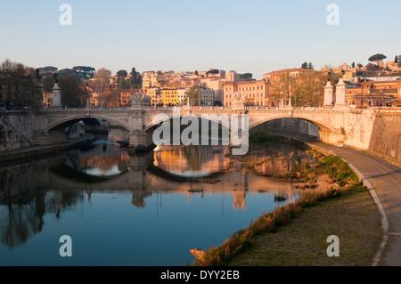 Morning sunlight on the Ponte Vittorio Emanuele over the River Tiber in Rome, Italy - Stock Photo