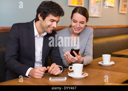 Female male coffee bar cell phone - Stock Photo