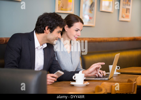 Business woman man computer colleague restaurant - Stock Photo
