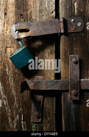 Close up of padlock and old metal hasp and staple on an old wooden door - & Padlock and rusty hasp on a weathered panel door Stock Photo ...