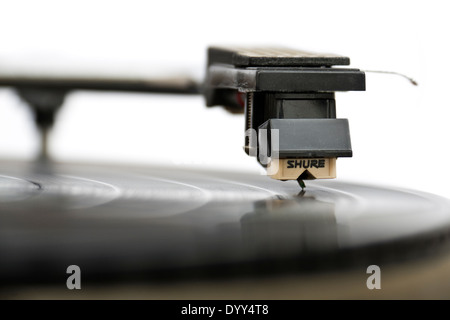 Close-up of vintage turntable with Sure stylus resting on vinyl record - Stock Photo