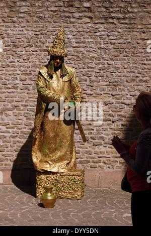 Golden man, human statue, street entertainer, busker, Bruges, Belgium - Stock Photo