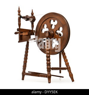 Wooden handmade spinning wheel against white background - Stock Photo