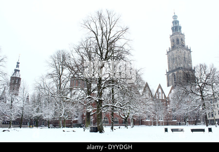 Wintery Martinikerhof with Martinitoren tower, one of the oldest squares in the medieval city center of Groningen, - Stock Photo