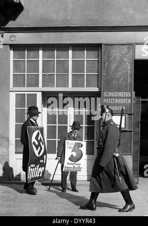 Men with election posters, 1933 - Stock Photo