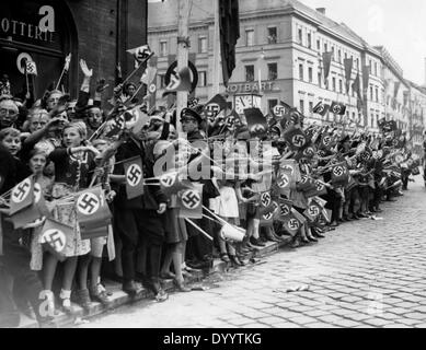 Cheering crowds at Hitler's and Mussolini's visit in Munich, 1938 - Stock Photo