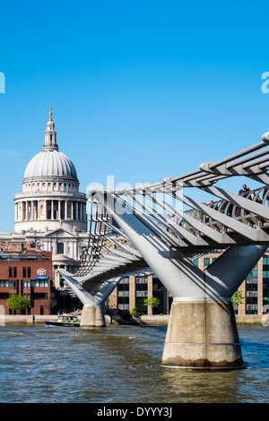 Millennium Bridge and St Paul's Cathedral in London United Kingdom - Stock Photo