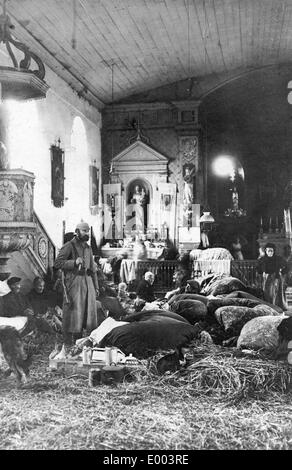 French refugees in a church on the Western Front, 1914 - Stock Photo