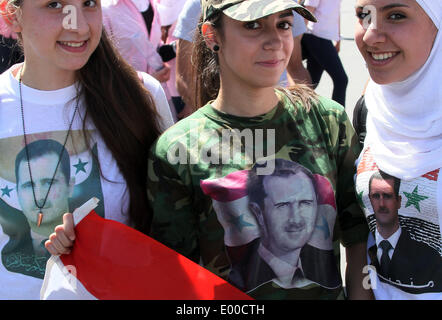 Damascus, Syria. 28th Apr, 2014. Syrians take part in a rally to show support for President Bashar al-Assad in Damascus, - Stock Photo