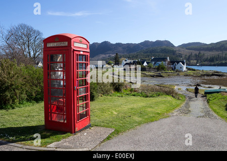Red Telephone Box in the Village of Plockton West Coast of Scotland UK - Stock Photo