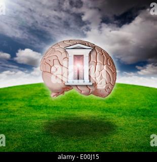 Digital composite of an open door on a brain model - Stock Photo