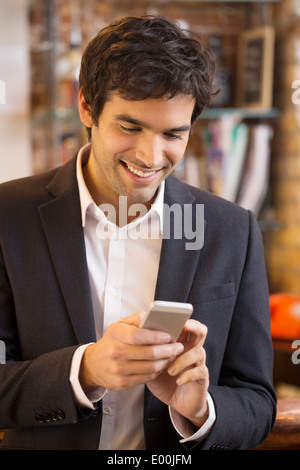 Male cheerful mobile phone smiling restaurant - Stock Photo