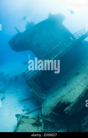 Scuba divers around the Odyssey Wreck off Roatan, Honduras. - Stock Photo