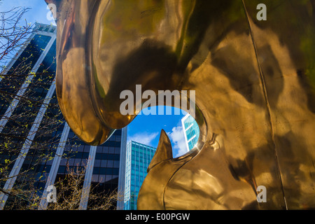 Towers of downtown Vancouver through an opening in a brass statue. - Stock Photo