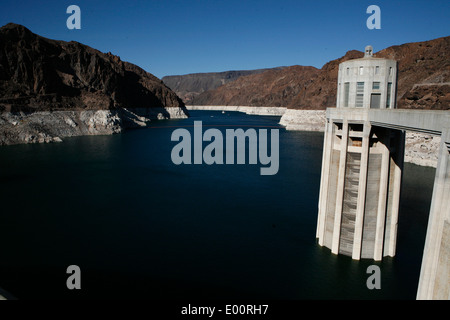 Large intake towers take water from lake Mead into the dam to create hydroelectric power. - Stock Photo