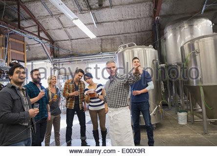 Man guiding tour at brewery - Stock Photo