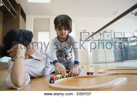 Mother and son playing with toy train - Stock Photo