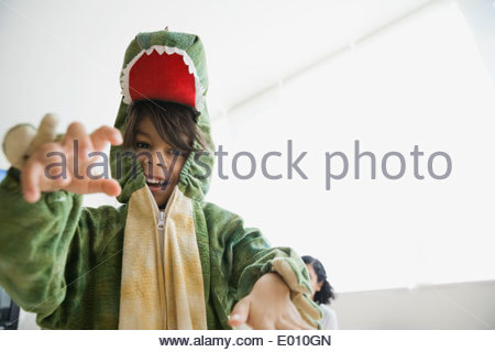 Playful boy in dragon costume - Stock Photo