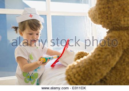 Girl in costume playing nurse - Stock Photo