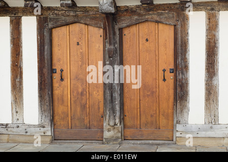 wooden doors on the 15th century black and white half timbered almshouses in Church Street, Stratford-upon-Avon - Stock Photo