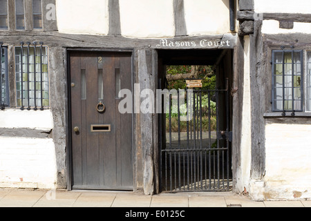 Masons Court entrance to 15th century black and white half timbered almshouses in Church Street, Stratford-upon - Stock Photo