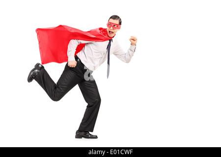 Scared man in superhero costume running away from something - Stock Photo