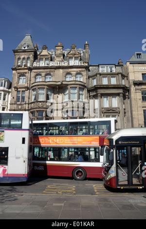 Buses outside of the Royal British Hotel on Princes Street Edinburgh. - Stock Photo