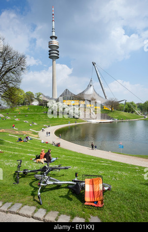 People outdoors in Spring weather at Olympic Park in Munich Bavaria Germany - Stock Photo